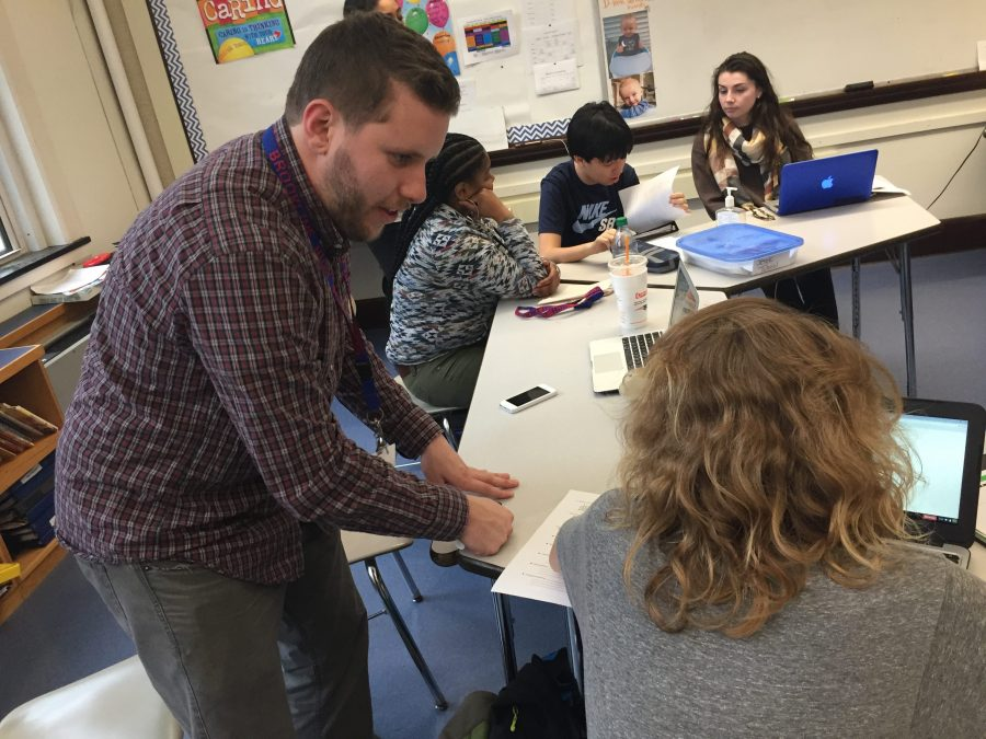 Always here to help! Paraprofessional Danny Costigan assists students in a Community Based Classroom