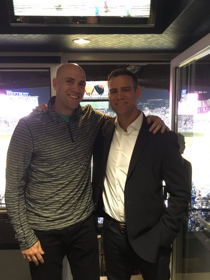 Alumni Theo Epstein stands with his brother Paul Epstein, who is a social worker at the high school.