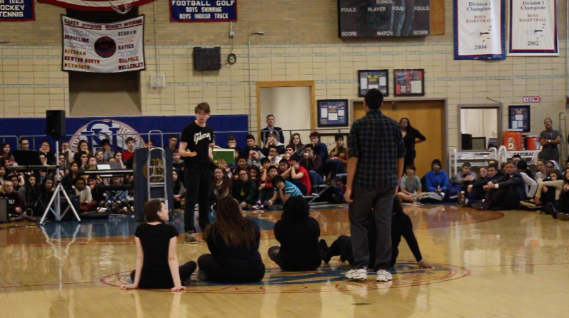 Actors in Every 28 Hours perform a preview at the MLK Assembly on Jan. 19. They debuted a small number of their short scenes, including the one shown above, which featured a student demanding racially unbiased teaching in a classroom. MAYA MORRIS/SAGAMORE STAFF