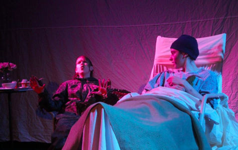 In the glow of a hallucination, talking crocodile Reagan (sophomore Alyssa Parkhurst) muses with the sickly Peter (junior Jacob Zachary Flanders) in a poignant scene during Borne into the Clouds. PROVIDED BY MIKI LAZOWSKI