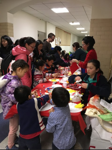 Children+make+crafts+during+the+Pan-Asian+Lunar+New+Year+festival.+The+day%27s+festivities+were+well-received+by+those+who+attended.