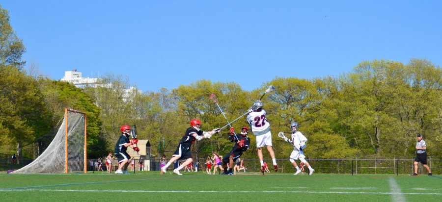 Senior+Nicholas+Gerszten+directs+a+shot+at+goal+against+Milton+High+School+at+Downes+Field.+Gerszten+will+be+continuing+his+lacrosse+career+this+spring+season.+