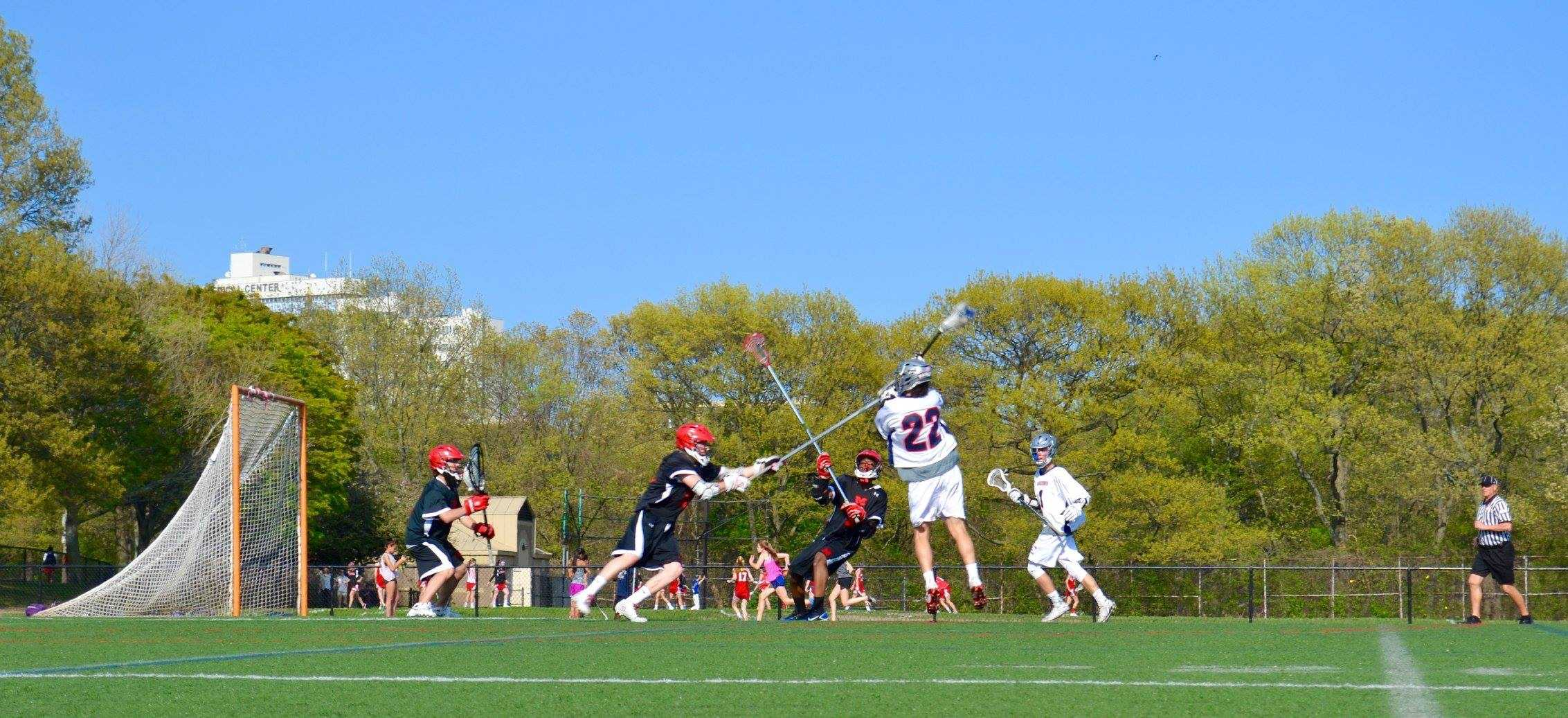 Senior Nicholas Gerszten directs a shot at goal against Milton High School at Downes Field. Gerszten will be continuing his lacrosse career this spring season.