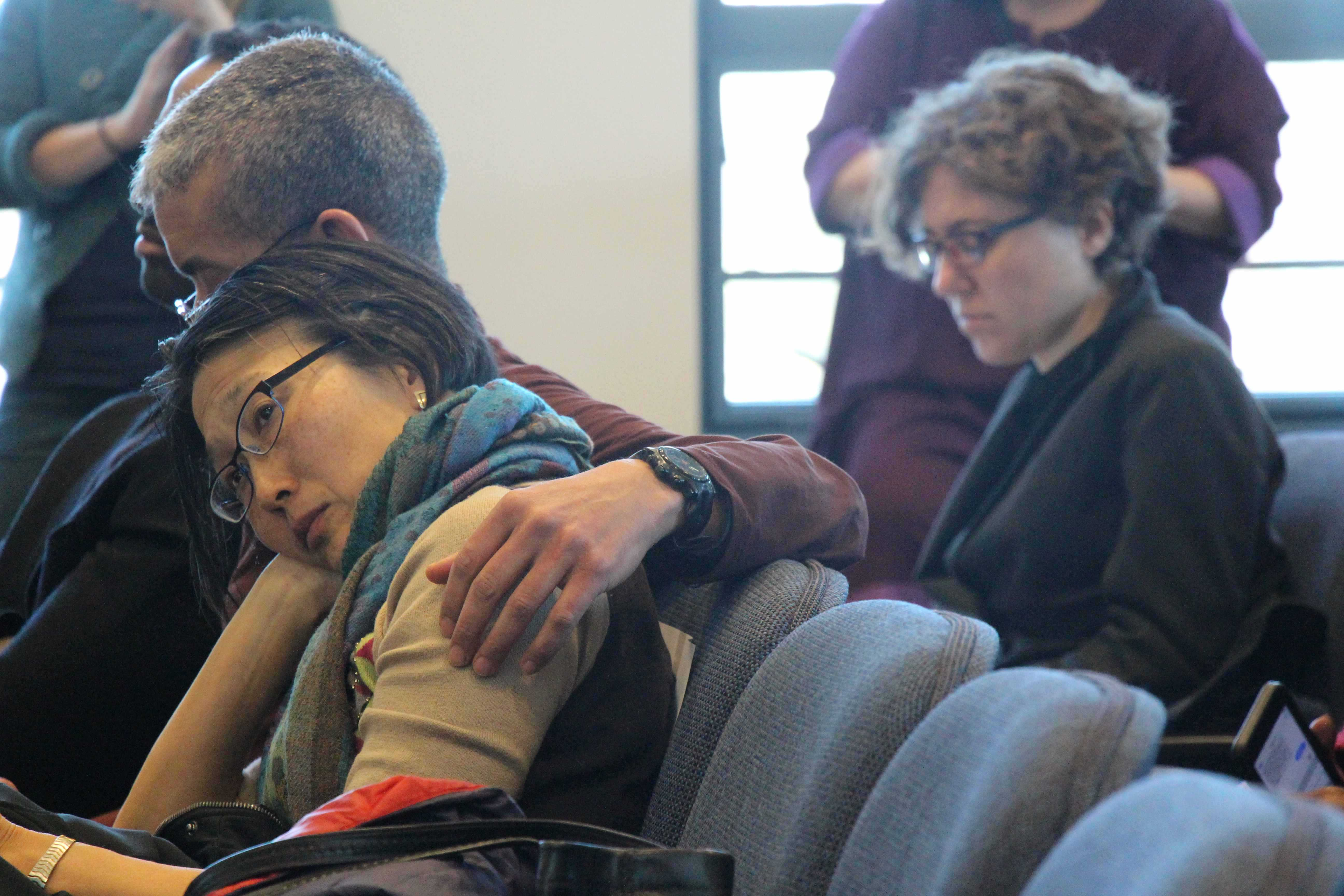 Officer Prentice Pilot embraces his wife at the hearing for his and Officer Estifanos Zerai-Misgun's potential termination on March 3.
