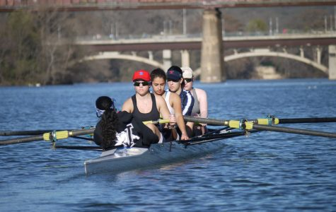 Four members of the crew team practice for their upcoming meet at the Charles River