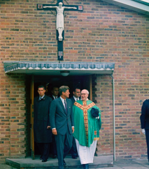 Kennedy departed from Our Lady of the Forest Church in Forest Row, England with Father Charles P. Dolman and Secret Service agents after mass in 1963. PHOTO FROM PUBLIC DOMAIN