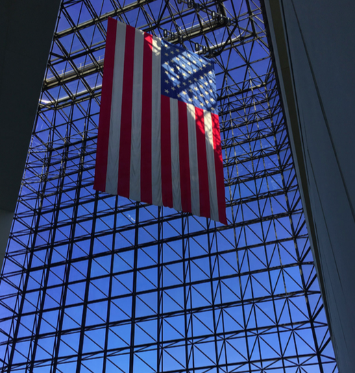 The American flag hangs from the rafters in the JFK Library. The museum highlights Kennedy's personal life and presidency. NATALIE JEW / SAGAMORE STAFF