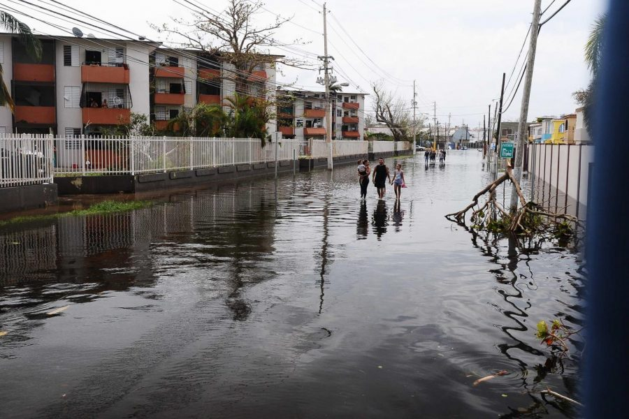 A+family+walks+down+the+flooded+streets+of+San+Juan%2C+Puerto+Rico+after+Hurricane+Maria.%0ATHE+DEPARTMENT+OF+DEFENSE