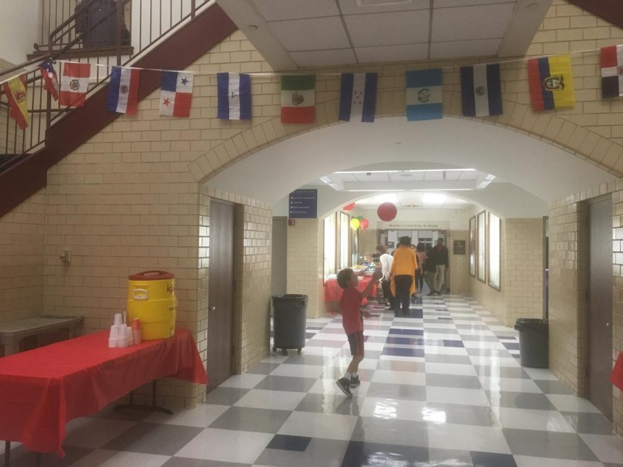 Members of the Brookline community  enter the MLK room in anticipation of the Hispanic Heritage Month Fiesta on Oct. 19. DAISY ELLIOT / SAGAMORE STAFF