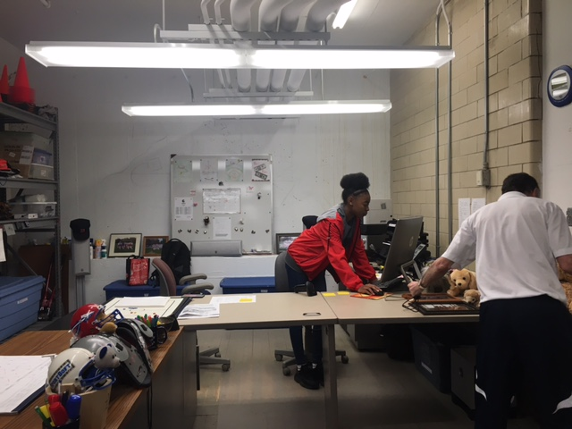 Sophomore Autumn Johnson and Marc Lofchie work in the equipment room performing a variety of tasks such as organizing and scanning uniforms. MADDIE NAGLER/SAGAMORE STAFF