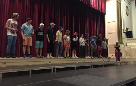 The cast of Needs Improvment watches senior Emily Gerson rant during an improv game called