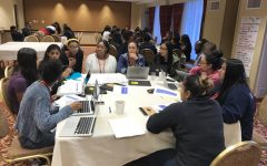 Students gather around a table at the MSAN conference in Cleveland. According to MSAN adviser Erin Blette, the students focused their research on disciplinary action.