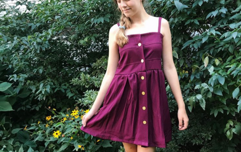 Ava French models a dress for her business, Keep It Going, which turns used clothes into fresh pieces. French used her skills from the business classes to start Keep It Going.