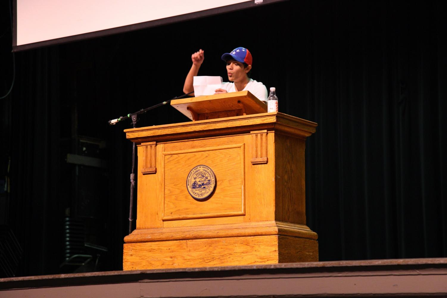 Junior Diego Echeverria de Cordova speaks from his heart about his homeland, Venezuela, during the E-block assembly about immigration. Echeverria de Cordova was one of many student speakers that spoke at Asking for Courage Day. CONTRIBUTED BY SANDER SOROK