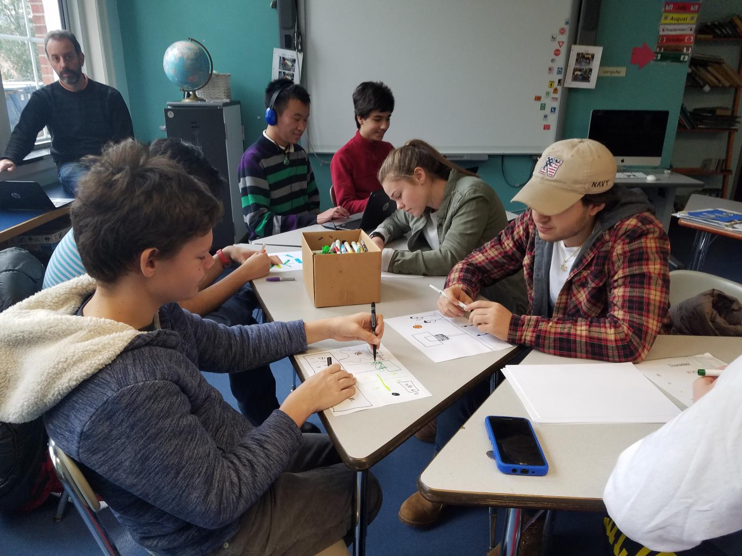 Students in the Best Buddies club draw with their buddies. The club at the high school is just one of the organization's many programs.