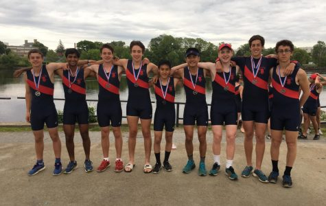 The boys varsity crew team poses following the Mass Pubs regatta in Lowell, MA. According to junior Eric Jamous, many rowers start crew their freshmen year, which pushes the athletes to work even harder because they all start with the same skills.