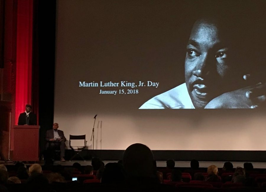 The+iconic+photo+of+Dr.+King+presides+over+the+Coolidge+Corner+Theater+as+speakers+prepare+their+remarks.+NATALIE+JEW%2FSAGAMORE+STAFF