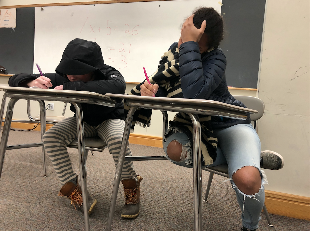 Students often resort to wearing full winter gear in class in an attempt to combat the cold and to help their learning experience.