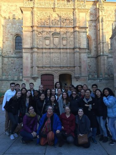 Students and teachers from last year's Spanish trip to Spain pose outside the University of Salamanca, which was built in the 13th century.