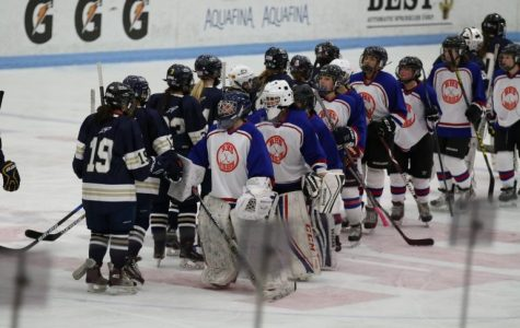 Dressed in red, blue and orange jerseys, the Warrior-Lions hockey team shakes hands with Needham. The team is comprised of athletes   from Newton South High School and Brookline High School.