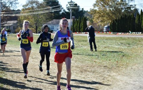 Freshman Vivian McMahon runs at the Eastern Massachusetts Division 1 Championship on Nov 11. According to McMahon, the greatest part of running at the high school is the people.
