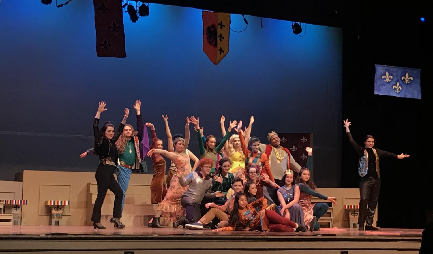 The cast of Pippin poses after the opening hit song,