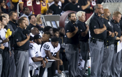 Players on the Oakland Raiders kneel during the national anthem, provoking outrage from some Americans. Their kneeling acts as a peaceful protest in the name of racial equality.