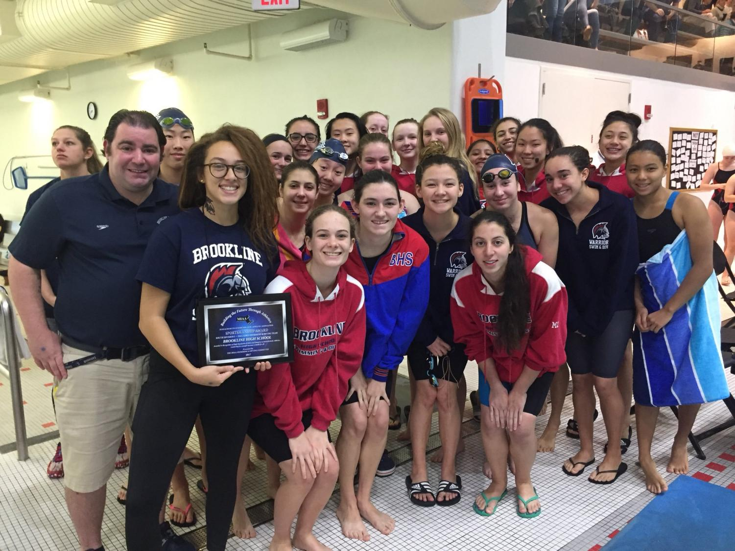 The girls swim and dive team poses after receiving the sportsmanship award. Captain Ali Keenan said they won the award because of the way they handled their losses.