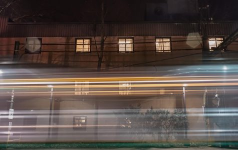 A train blasts by the rear of the Brigham and Women's Physicians Organization building. The location is planning to be replaced with a new part of the campus in the coming high school expansion.  NICK EDDINGER/SAGAMORE STAFF