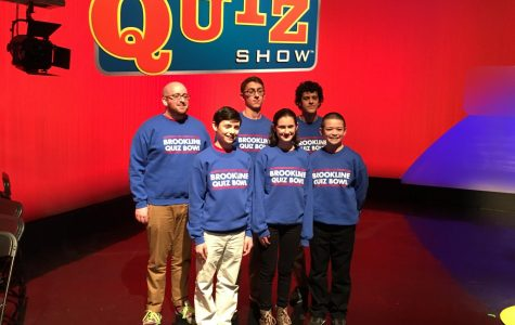The student competitors from the high school and teacher advisor Adam Fried pose on the set of the High School Quiz Show, where they defeated Thayer Academy to advance to the semifinals.