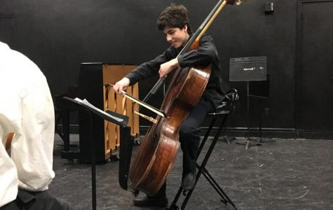 Sophomore Reuben Ramos  plays his bass emphatically during this year's chamber music festival in the black box.