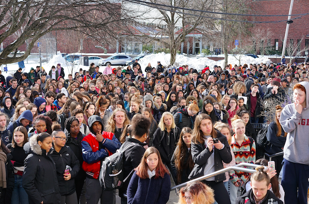 Students gathered on Greenough Street in front of the high school listen to speeches given by the organizers of the walkout.