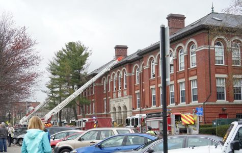 Fire engines line the entrance of the Unified Arts Building on Wednesday, as concerned members of the community look on. There was a minor fire in the building.