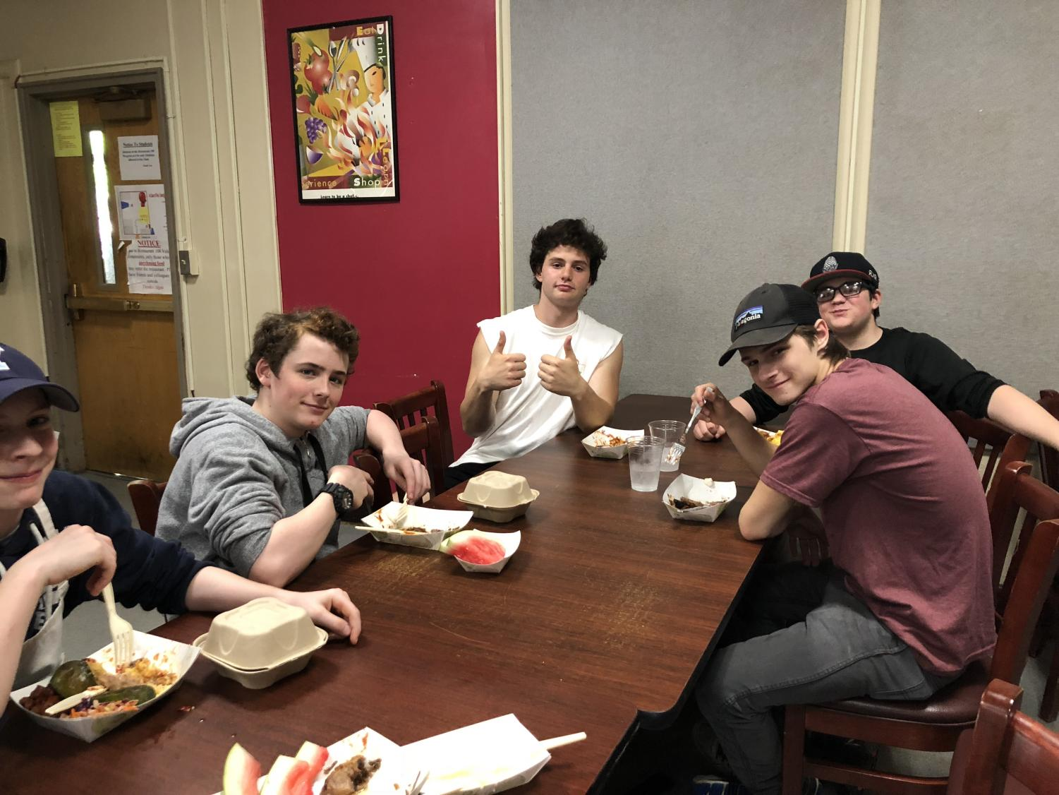 Freshman Jonah Lenoch (along with junior Lucas Mitchell, sophomore Alexander McDowell and freshman Bobby Southward) eats after cooking a barbeque-themed menu for Top Chef. Lenoch followed a family tradition of celebrating the Fourth of July with barbecue.
