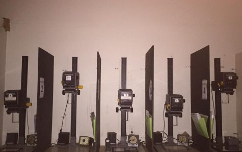 The enlarger machines inside the dark room are necessary to develop the photos to be in the best quality.