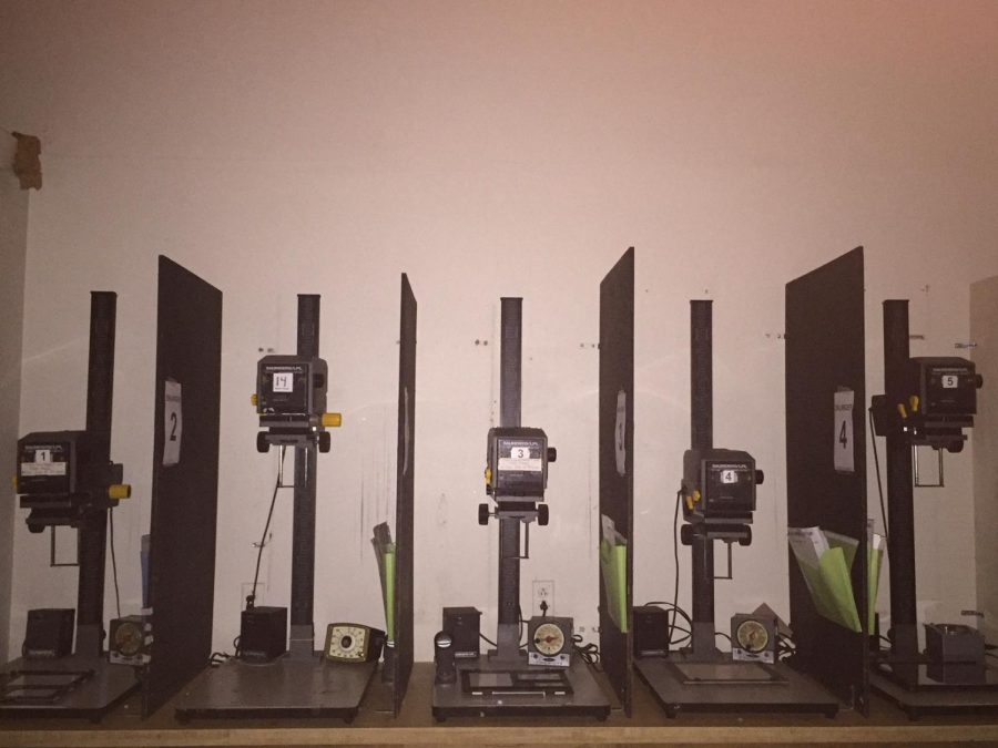 The+enlarger+machines+inside+the+dark+room+are+necessary+to+develop+the+photos+to+be+in+the+best+quality.