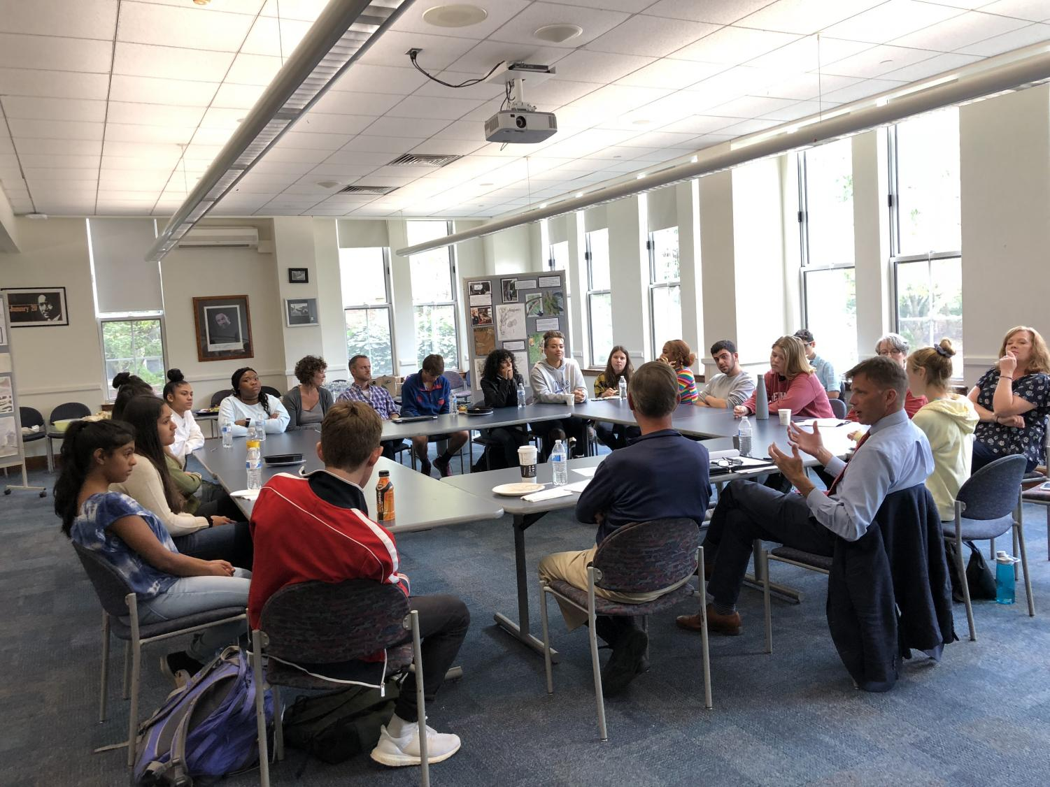 Ted Dintersmith and students hold a roundtable discussion surrounding topics like college and new innovations in education. Dintersmith, author and innovator, visited the high school on Sept. 20.