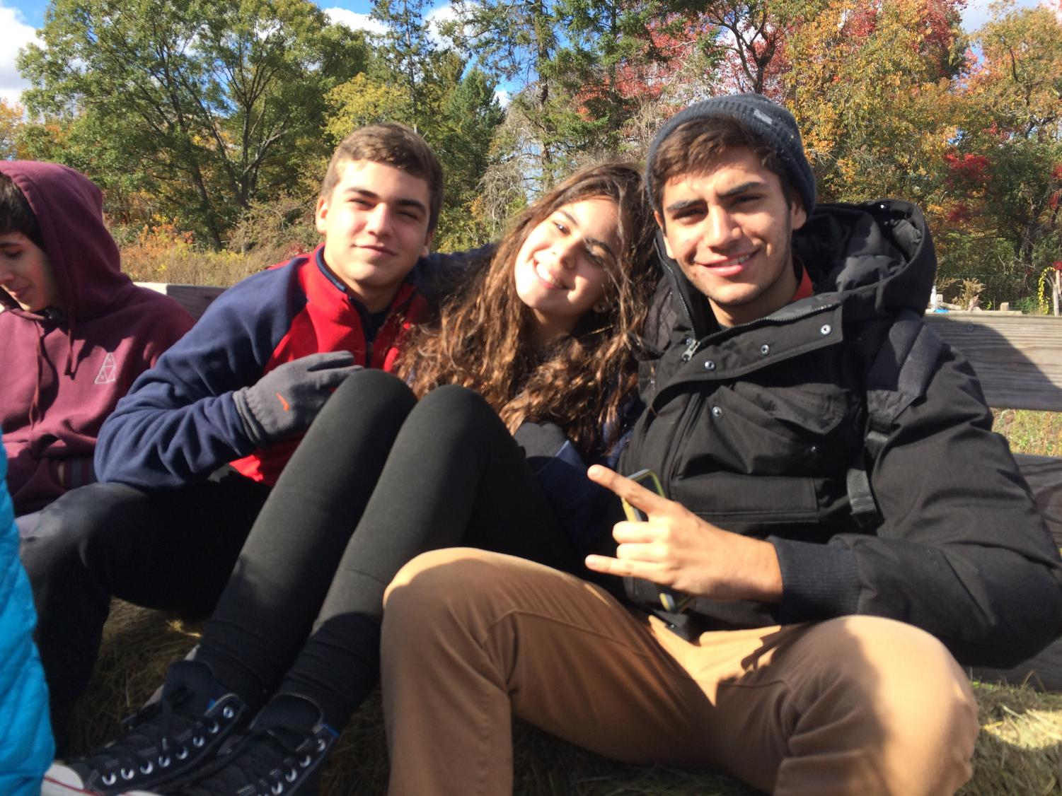 International students come together for an annual fall apple picking trip at Russel Orchards in Ipswich. Bonding activities such as these provide valuable peer support.