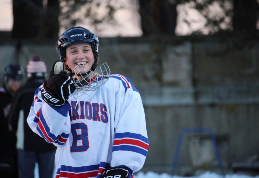Junior+Mia+Liss+celebrates+during+a+hockey+game.+Liss+plays+three+seasons+of+sports+because+she+enjoys+exercising+with+friends+in+all+of+the+grade+levels.