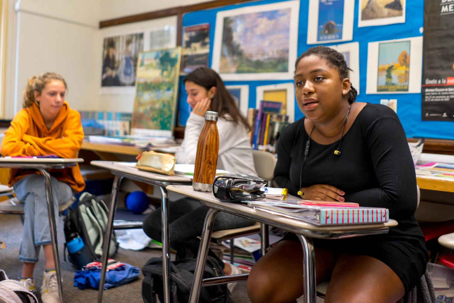 Junior Maria Harris (right), a student in Kimball's French IV honors-advanced class, engages in a discussion. In dual-leveled classes, all students are challenged with advanced-level material.
