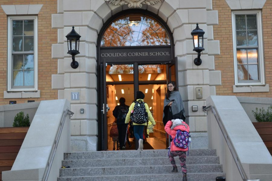 Students trickle into the Coolidge Corner School, once named the Edward Devotion School. The temporary name has sparked conversations, with students having a voice in deciding the new name.