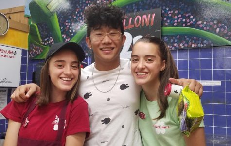 Junior Ryan Liang poses with Allie and Jackie Mundis '18.  Liang says that his job at Trader Joe's has given him a community and has taught him important skills.