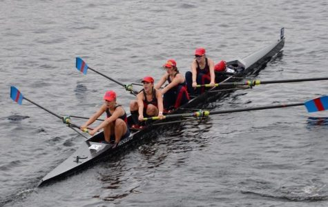 Crew team races in Head of the Charles Regatta