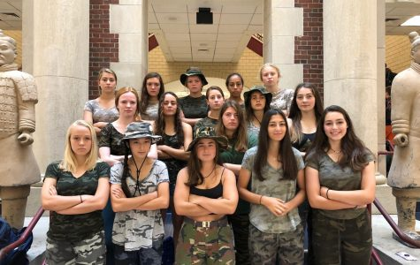 The girls varsity soccer team shows their spirit by wearing camo before a game.