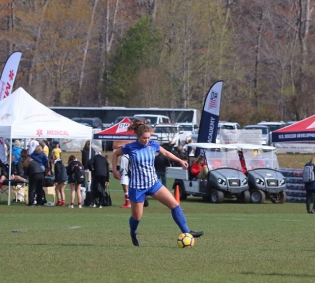 Junior Serena Sink runs up the field during a soccer tournament. Sink recently committed to play women's varsity soccer at Wesleyan University in Connecticut.