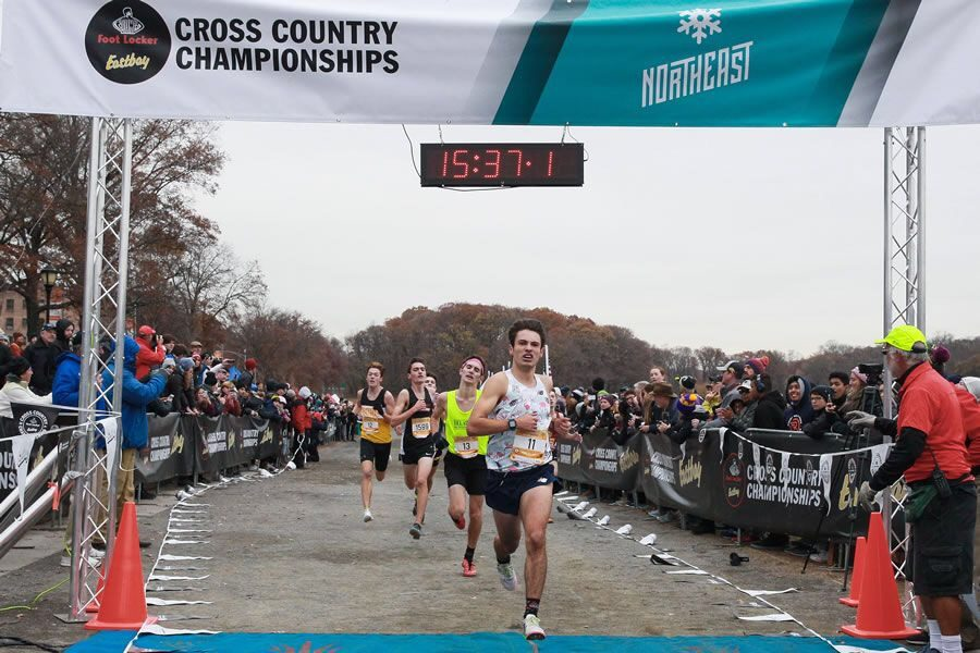 Lucas Aramburu crosses over the finish line at the Northeast Cross Country Championships. Aramburu inspires his teammates through his hard work and dedication to the sport.