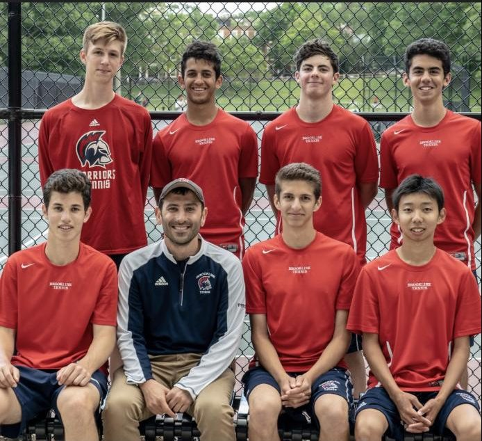 Coach and math teacher Nick Pero poses with his boys varsity tennis team. His work day lasts up to 11 hours. Pero thinks organization is key to balancing two jobs.