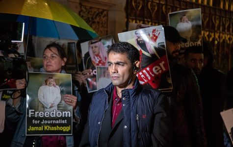 In a Saudi National Day celebration at the Natural History Museum in London, Saudi Arabian activist Ghanem al-Dosari protests outside.
