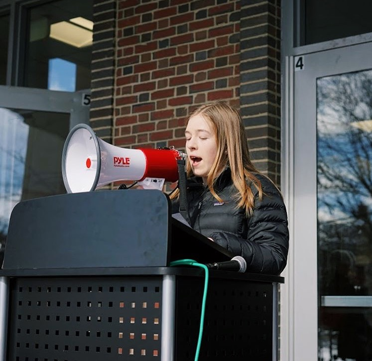 Sophomore Charlotte Vincent speaks during the National School Walkout, which protests against gun violence, at the high school.