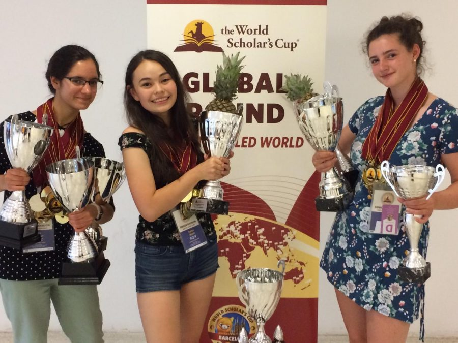 The+World+Scholars+Cup+club+co-presidents+and+co-founders+Sophia+Maehl%2C+Sophie+Tsekov+and+Julia+Riesman+celebrate+with+trophies+after+winning+the+final+round+of+the+competition.